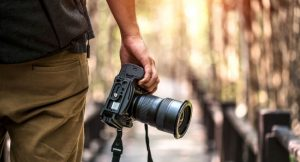 Image of A Professional Photographer With pro-Camera In His Hand - Professioanal Photography Concept.
